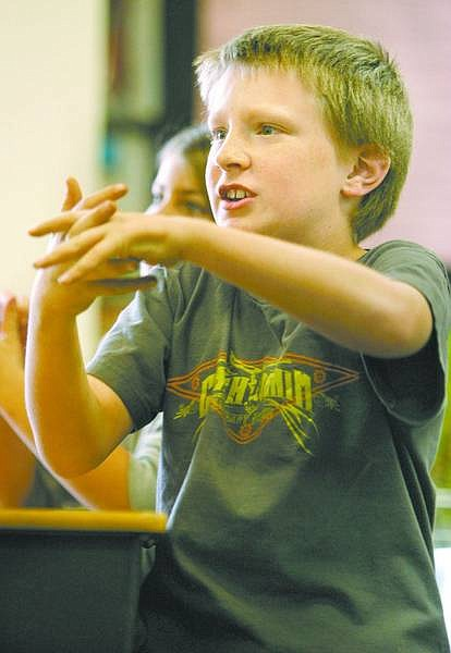 Cathleen Allison/Nevada Appeal Fremont Elementary School fourth-grader Christopher Rose, 9, practices washing his hands Friday during a presentation by nursing students from the University of Nevada, Reno.