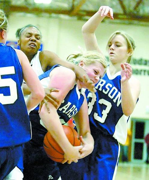 BRAD HORN/Nevada Appeal Carson's Natalie Morrow, center, tries to control the ball against Centenial while Carson's Tiffany O'Day assists at Carson Middle School on Friday.
