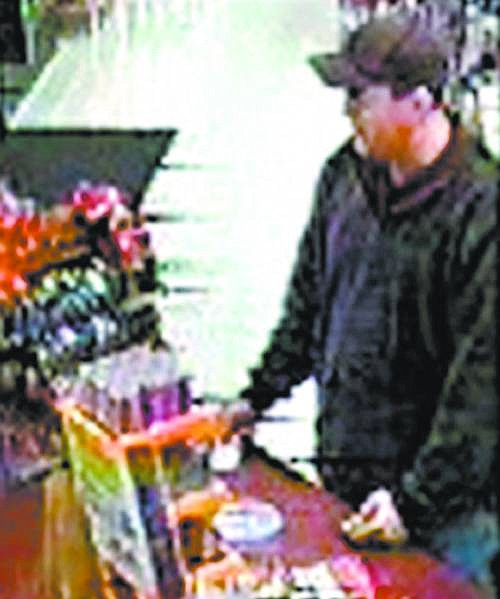 Police want to know who  the man is in this image taken from surveillance video. He's seen here using a stolen credit card to make a $16 purchase at Quik Stop on Roop Street and Hot Springs Road on Nov. 18.   photo provided
