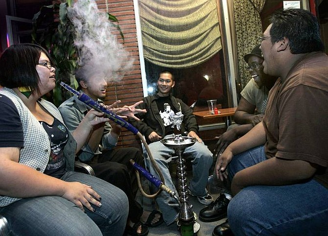 Kayla Crow, left, John Guava, Ryan Tong, Brian Bello and Tim Cheung at Long Beach's Mirage Coffeehouse and Hookah Lounge. Hookah bars are popular among 18- to 24-year-olds.