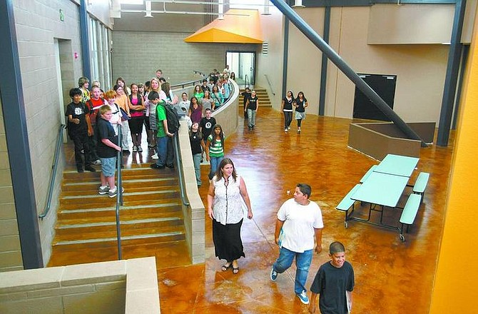 Cathleen Allison/Nevada AppealCarson Middle School teachers take students on tours of the newly remodeled campus Monday. Construction of an additional 40,000 square feet was completed during the summer.