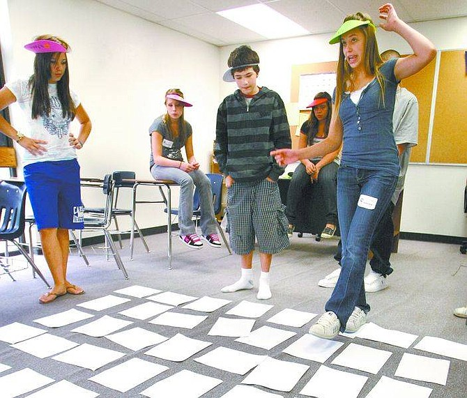 Cathleen Allison/Nevada AppealKarenza Strode, 14, and a group of fellow freshman play team-building games during freshmen orientation Tuesday at Carson High School. More than 700 freshman join the ranks at CHS next week.