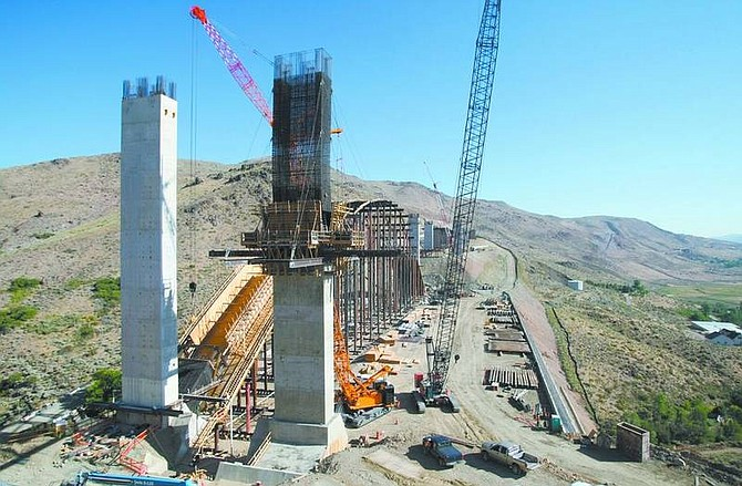 Cathleen Allison/Nevada AppealConstruction continues Friday on the I-580 freeway project in Pleasant Valley. The 8.5-mile stretch includes nine bridges, with the largest bridge (shown here) spanning 1,719 feet across Galena Creek with a 690-foot cathedral arch.