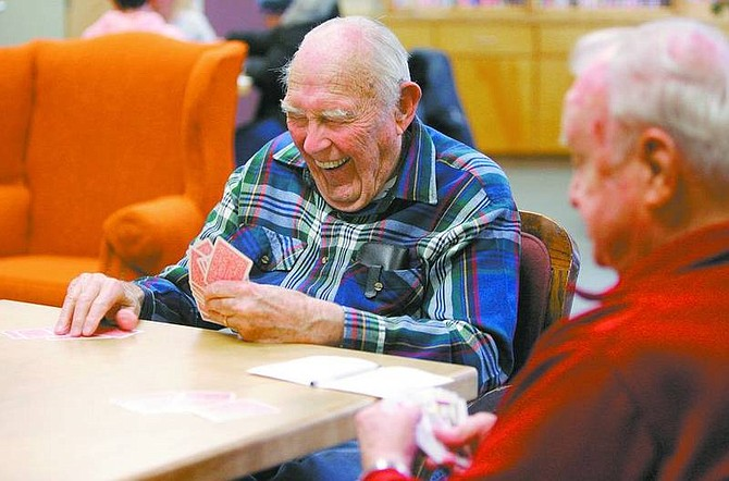 Cathleen Allison/Nevada AppealBob Crowder and Jim Mathis play pinochle at the Carson City Senior Citizens Center recently. Health officials recommend a variety of games, activities and exercises to keep an aging brain healthy.