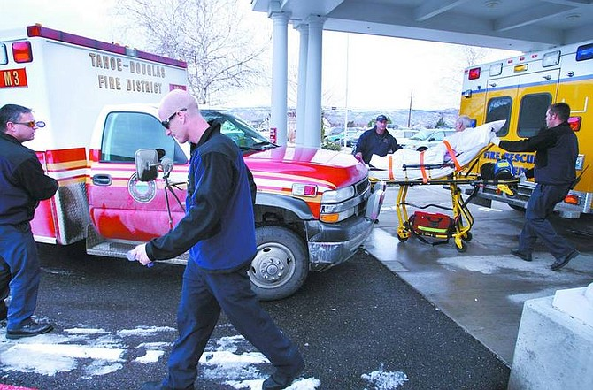 Cathleen Allison/Nevada Appeal Carson City Fire personnel load a patient at Evergreen Carson City on Thursday afternoon as a paramedic crew from Tahoe Douglas Fire arrives to handle a separate medical call. On Thursday, emergency services were dispatched to 39 calls.