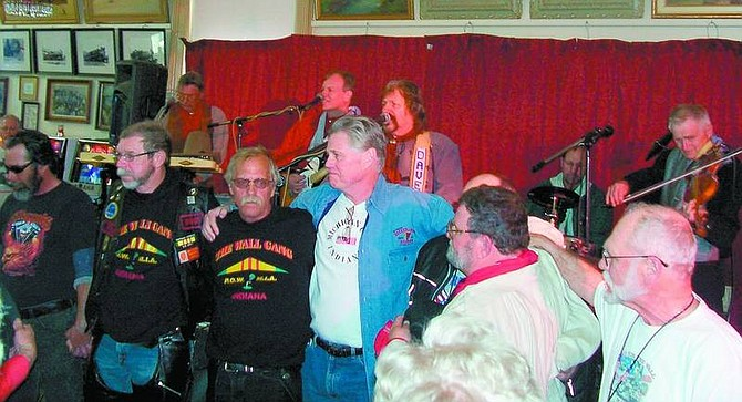 Karen Woodmansee/Nevada Appeal A group of Vietnam veterans were honored at the Bucket of Blood in Virginia City by David John and the Comstock Cowboys and their audience on Sunday.
