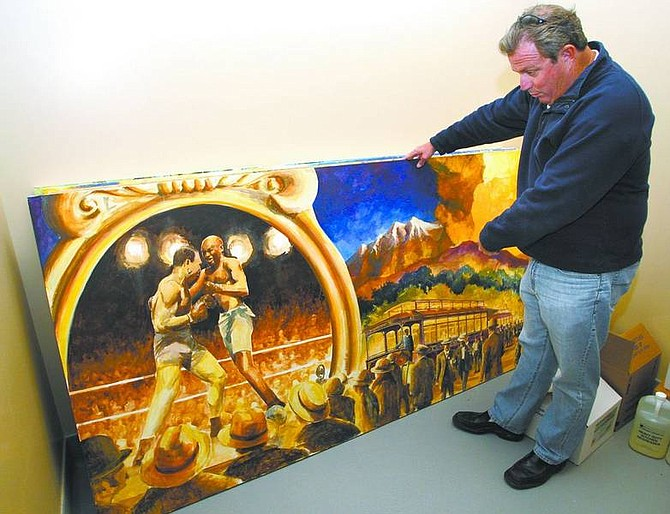Cathleen Allison/Nevada Appeal Bodines owner Mike Pegram looks through panels of Nevada-themed artwork that will be hung in the new South Carson City casino. Artist Larry Henry is also the architect and designer of the project.