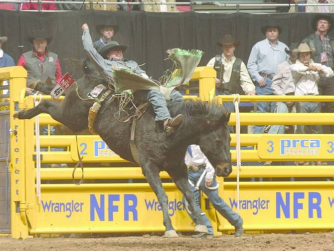 Photo courtesy of Professional Rodeo Cowboys Association Elko bareback rider Paul Jones, shown here at the 2006 National Finals Rodeo, uses his wife's car for weekend travel to save money on fuel.