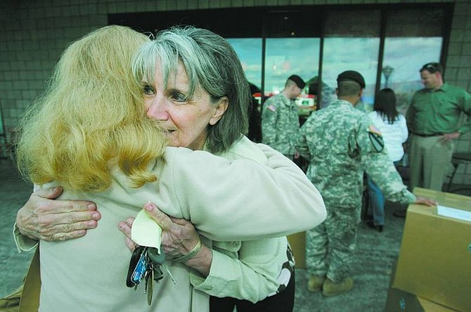 BRAD HORN/Nevada Appeal Kathy Brockway hugs Jo Sprinkle at the Starbucks store in north Carson City on Wednesday. Starbucks locations in Northern Nevada are sending 300 pounds of coffee to soldiers stationed in Iraq. Brockway's son Aaron is stationed in Iraq.