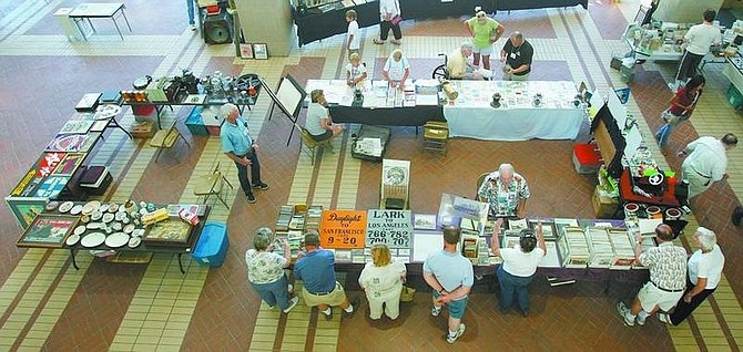 BRAD HORN/Nevada Appeal Vendors show railroad items to customers at the Railroadiana show at the Nevada State Library and Archives on Saturday