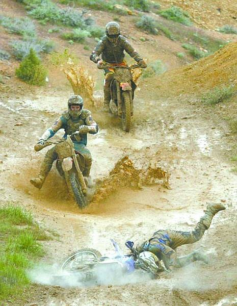 Brad Horn/Nevada Appeal FILE PHOTO  Riders try to avoid Dylan McFarlane, of Virginia City after he crashed in a mud puddle at the bottom of a jump along the 19-mile round trip course during the Grand Prix at Virginia City May 1, 2005, in Virginia City.
