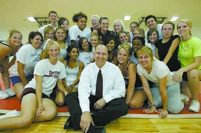 BRAD HORN/Nevada AppealDayton High School's new principal, Wayne Workman, sits in the gym with the Dayton High School cheerleading squad during their training camp Friday.