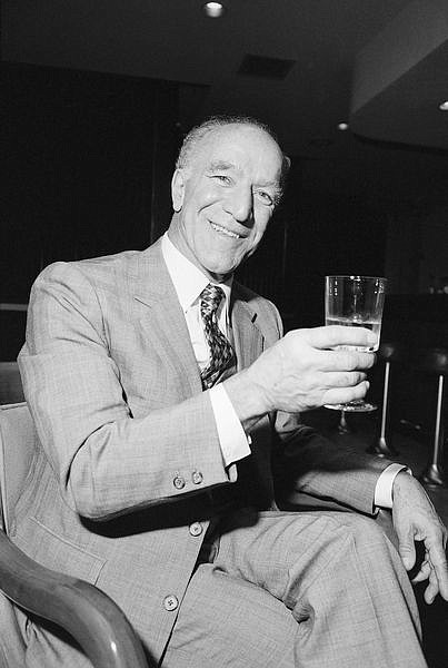 **FILE** Robert Mondavi, who built the first new winery in the Napa Valley since prohibition, raises a toast during an interview on March 14,1984. Mondavi is among the major premium vintners who put California on the international wine map. A winery spokeswoman says the California winemaking patriarch is  dead at 94.  (AP Photo/Eric Risberg)