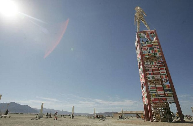 Brad Horn/Nevada Appeal Burning Man festival participants visit 'The Man' on the playa at the Black Rock Desert in Gerlach on Tuesday.