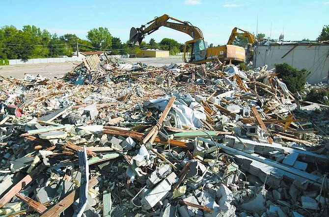 Cathleen Allison/Nevada Appeal Empire Construction excavators began to tear down several buildings at the former National Guard Armory on Wednesday.