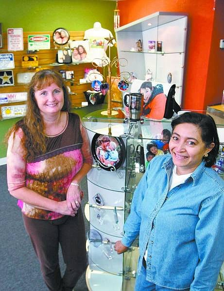 Cathleen Allison/Nevada Appeal Cathy Vairo, left, and Diana Smith are co-owners of ServiceFlags.com and have recently launched the National Award and Trophy Company.