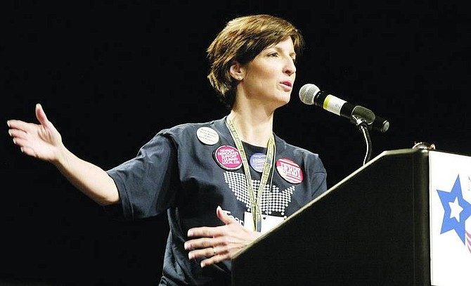 Amy Lisenbe/Nevada Appeal Carissa Snedeker of Lyon County, rural caucus chair, gestures as she speaks Sunday morning at the Nevada state Democratic convention at the Grand Sierra Resort, which concluded Sunday.