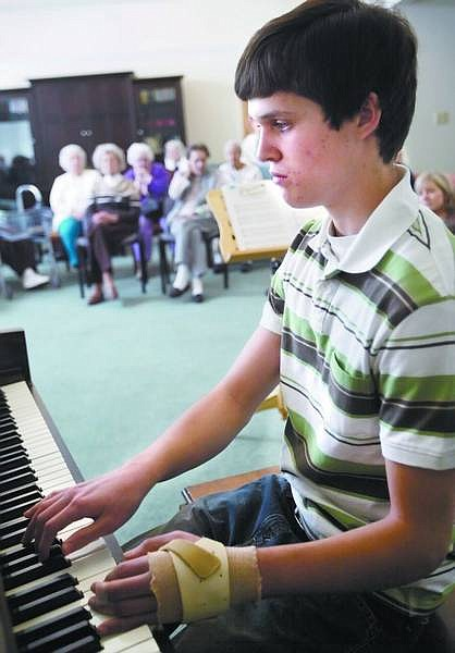 Amy Lisenbe/Nevada Appeal Colter Thomas, Carson High School senior, performs for Sierra Place residents Sunday afternoon as part of his senior project. Some of his music students also performed.