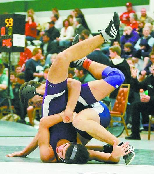 BRAD HORN/Nevada Appeal Carson's Junior Valladares, 15, wrestles Jacob Gil, 14, at the Northern 4A Wrestling Championships at Hug High School on Friday. Valladares won this match.
