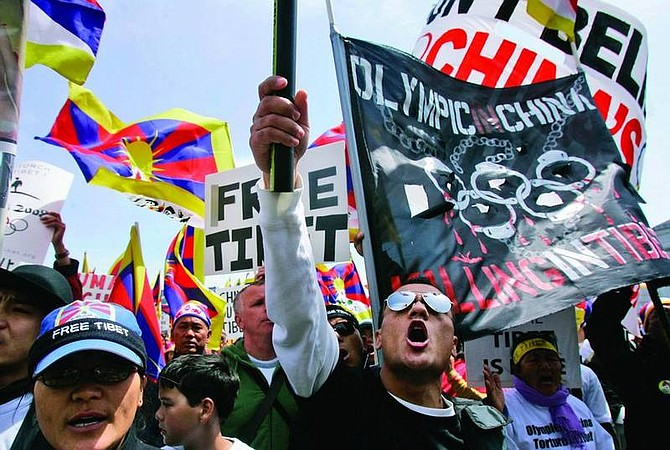 Tibetans and supporters yell at a rally in protest of China's Olympic torch at City Hall in San Francisco, April 8, 2008. Activists opposing China's human rights policies and a recent crackdown on Tibet have been protesting along the torch's 85,000-mile route since the start of the flame's odyssey from Ancient Olympia in Greece to Beijing, host of the 2008 Summer Olympics.  (AP Photo/Jeff Chiu)