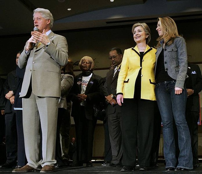 Elise Amendola/Associated Press Former President Bill Clinton introduces his wife, Democratic presidential hopeful Sen. Hillary Rodham Clinton, D-N.Y., while she stands with their daughter, Chelsea, at a rally in Charleston, S.C. Friday.