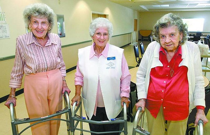 Cathleen Allison/Nevada Appeal Volunteers, from left, Margie Groth, Dorothy Crosby and Faye Wahl were among the volunteers honored Tuesday during an ice cream social at the Carson City Senior Citizen Center. Crosby has volunteered 18,500 hours, Wahl, 12,700 and Groth 9,000.