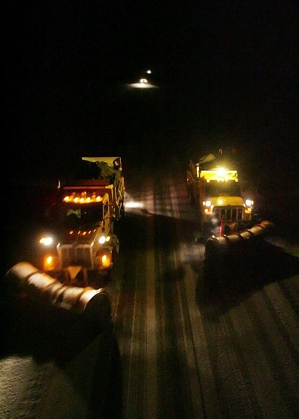 BRAD HORN/Nevada AppealNevada Department of Transportation snow plows carve a path for drivers in Washoe Valley at around 11:30 p.m. on Thursday evening.