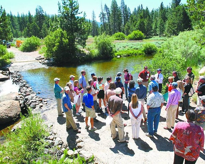 Jim Grant / Tahoe Daily Tribune Government and agency officials gather at the low-water crossing of the Upper Truckee River on Thursday morning before a groundbreaking ceremony for the city's river restoration project.