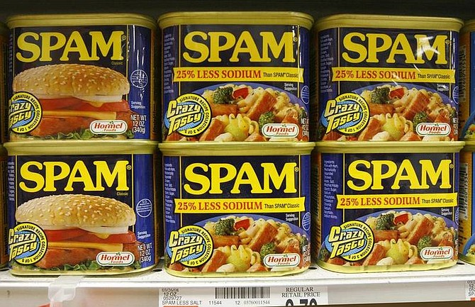 AP Photo/Toby TalbotCans of Spam line the shelves at a store in Berlin, Vt., Tuesday, May 27, 2008. Sales of Spam, that much maligned meat, are rising as consumers are turning more to lunch meats and other lower-cost foods as a way of stretching they're already stretched food budgets.