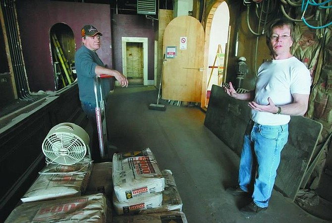 BRAD HORN/Nevada Appeal Ash Allen, left, bar manager, and Bill Beeson, discuss the restoration of the Old Corner Bar at Piper's Opera House on Saturday.