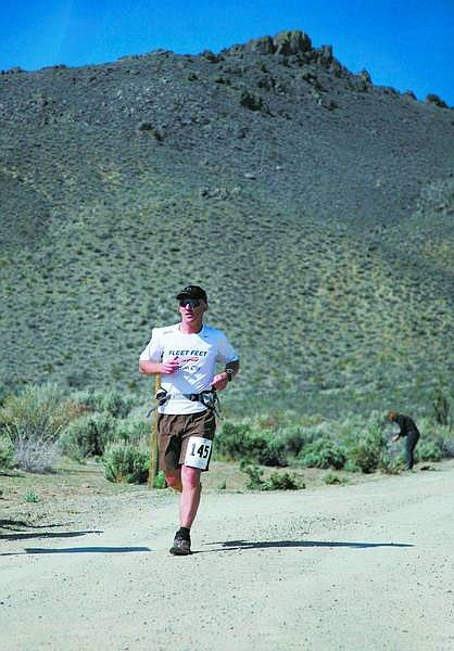 Emma Garrard/Nevada Appeal News Service Scott Keith of Carson City runs to the finish during the Escape from Prison Hill Half Marathon in Carson City on Saturday. The event drew 185 competitors.