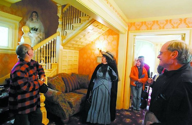 BRAD HORN/Nevada Appeal The Bride Ghost greets guests from the Ferris Mansion staircase during the Wild West Spring Ghost Walk tour on Saturday. Weston Spann played the part of the Bride Ghost.