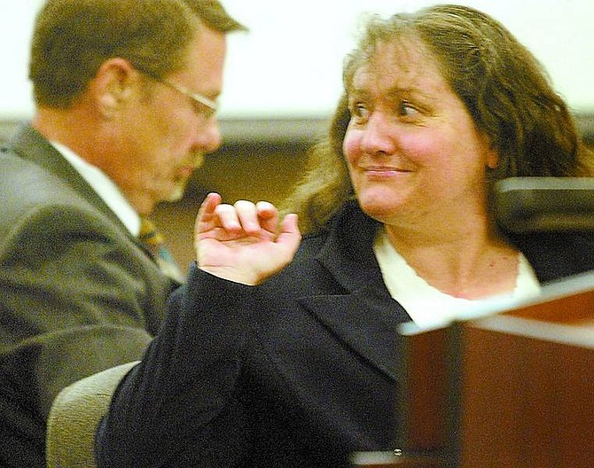 Shannon Litz/Nevada Appeal News Service Karen  Bodden waves to someone in the gallery of Judge Dave Gamble's court in Minden before potential jurors come in for jury selection in her murder trial on Monday.