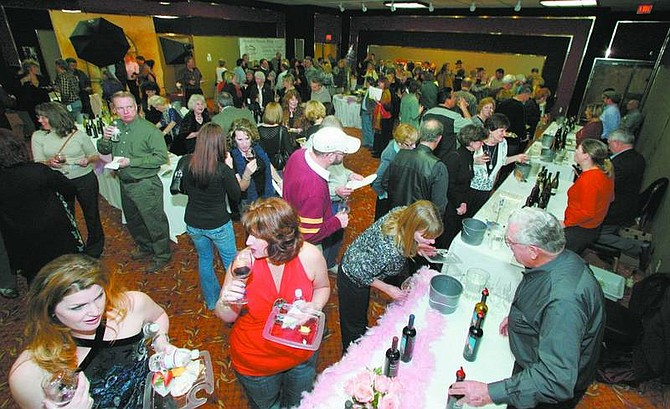 BRAD HORN /Nevada Appeal Patrons of the Winter Wine and All that Jazz fundraiser sample wine in the Carson Nugget Ballroom on Saturday.