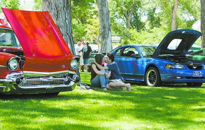 BRAD HORN/Nevada AppealA couple kisses on the lawn at Mills Park during the 14th annual Silver Dollar Car Classic on Saturday.