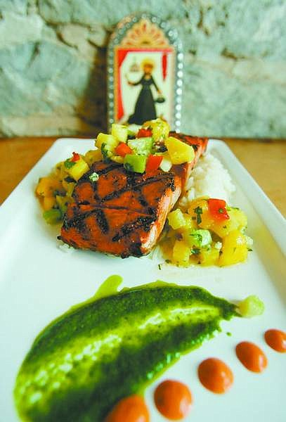 BRADHORN/Nevada Appeal Yucatan grilled mahi with tropical salsa.