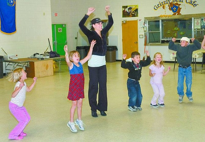 Steve Ranson/Nevada Appeal News Service Miss Carson City, Julianna Erdesz, second from left, spent one day in Fallon last week teaching dance and creative movement to local elementary students.