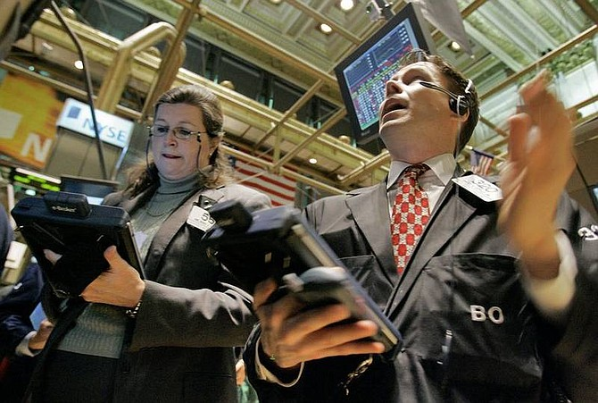 AP Photo/Richard DrewTraders Milissa Martin and Bruce Doyle work on the floor of the New York Stock Exchange on Friday. Stocks bounced around Friday after the government's much-anticipated February employment report came in weaker than expected and after the Federal Reserve announced steps to aid the credit markets.
