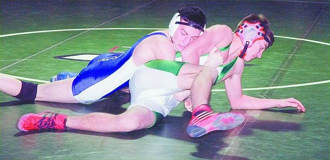 Steve Ranson Carson City's Todd Banko controls the Greenwave's Nick Borovac in the first period Wednesday as the Senators faced Fallon. Banko recorded a first-round pin, but Carson lost the dual, 53-24.