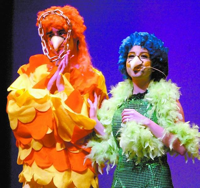 "Amy Lisenbe/Nevada Appeal Josh Wold, as Papageno, left, and Brooke Galyan, as Papagena/Greenbird, left, of the Fairytale Theatre group rehearse a scene from the ""Magic Flute"" Tuesday afternoon at the Carson City Community Center."