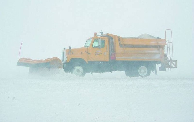 BRAD HORN/Nevada Appeal A Nevada Department of Transportation snowplow moves snow in Washoe Valley on Thursday. Winds between 10-15 mph are expected to continue through Sunday in Northern Nevada along with the chance of snow through the weekend.