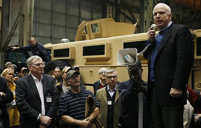 AP Photo/Charles DharapakRepublican presidential hopeful Sen. John McCain, R-Ariz., addresses workers during a visit to Force Protection, Inc., which produces armored vehicles, in Charleston, S.C., today. Force Protection produces Mine Resistant Ambush Protected (MRAP) vehicles for use in Iraq and Afghanistan.