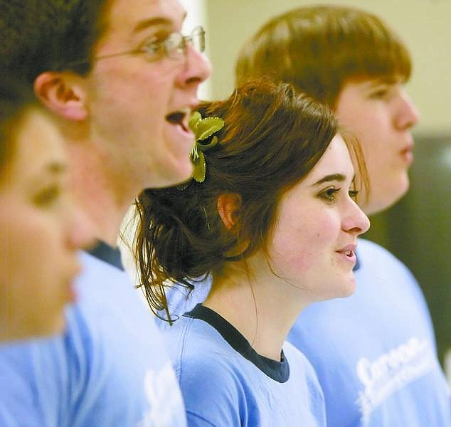 Amy Lisenbe/Nevada AppealCarson High School chamber singers Dakota Dutcher, left, Lainey Henderson, center, and Brian Lester, right, sing with the group Monday in preparation for an upcoming performance at the Community Center. The group recently earned top honors at a competition in San Francisco.