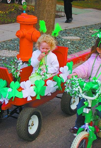 Submitted Photo Shelby Wickstead, 2, gets ready to ride in the St. Patrick's Day Parade at Kinderland on Curry Street on Friday.