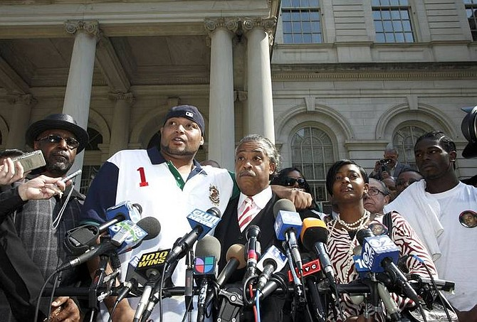 AP Photo/Jin LeeSean Bell's father William Bell,  friend Joseph Guzman, Rev Al Sharpton, fiancee Nicole Paultre-Bell, and friend Trent Benefield, from left, address the media on the steps of City Hall Wednesday, April 23, 2008 in New York. Three of the undercover officers involved in the strip club shooting were cleared Friday of manslaughter and other charges. Guzman and Benefield were injured in the Nov. 25, 2006 shooting that killed Sean Bell hours before his wedding.