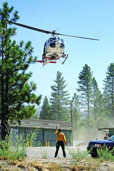 Jen Schmidt/Nevada Appeal News Service A helicopter with the Nevada Division of Forestry is guided to a landing spot in the upper parking lot of the Washoe County Sheriff Substation in Incline Village on Friday morning, where resources were being staged in the search and rescue operations for a small plane that crashed in the mountains just north of the town.                             A helicopter with the Nevada Division of Forestry is guided to a landing spot in the upper parking lot of the Washoe County Sheriff Substation in Incline Village on Friday morning, where resources were being staged in the search and rescue operations for a small plane that crashed in the mountains just north of the town.  Jen Schmidt/Nevada Appeal News Service