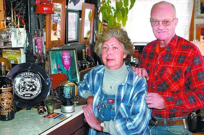Amy Lisenbe/Nevada Appeal Linda and Bruce Larson, owners of Botcha-Caloops Custom Glass Etching & Photos in Mirror, at their shop in Virginia City.