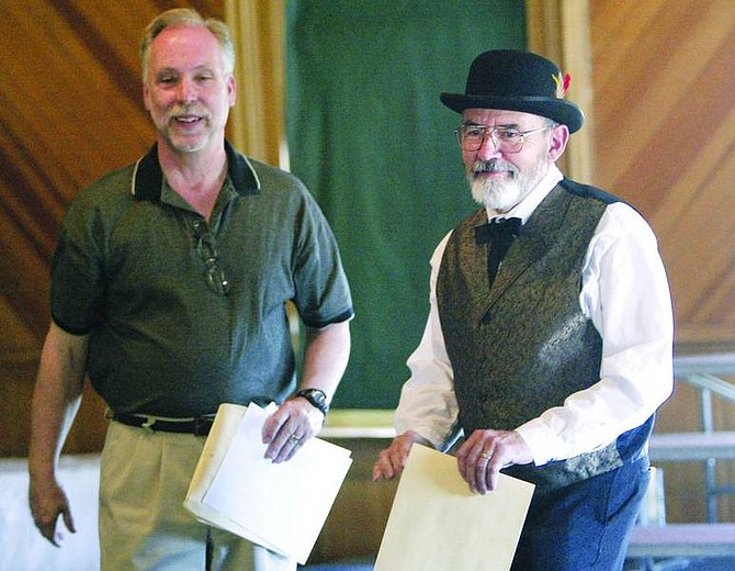 Amy Lisenbe/Nevada Appeal Chris Eichin, right, co-owner of the B Street House Bed and Breakfast in Virginia City, accepts his Preservation Award from Ron James, left, state historic preservation officer, Sunday afternoon at the Fourth Ward Schoolhouse in Virginia City at the annual awards ceremony.