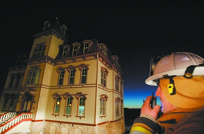 Brad Horn/Nevada Appeal Storey County Division Chief Eric Guevin works on a fire at the Fourth Ward School in Virginia City early Friday.