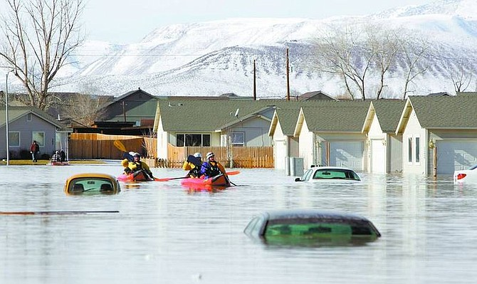 BRAD HORN/Nevada Appeal File PhotoReno rescue team members search a neighborhood in Fernley on Jan. 5 after a canal levee ruptured from heavy rainfall.